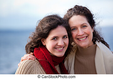 Mother and daughter - A portrait of a mother and her...