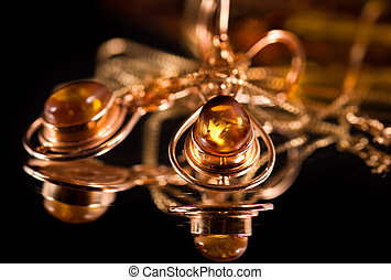 Golden earrings with precious stones amber