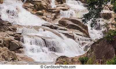 closeup cascade of waterfalls on mountain stream in park -...