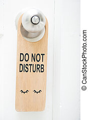 do not disturb sign hanging on the door
