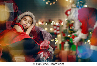 Santa Claus making a surprise for little sleeping girl