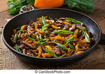 Beef with sweet peppers, beans. - Stir frying beef with...