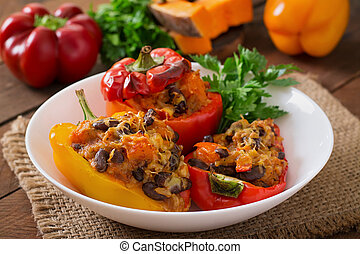Stuffed peppers with rice, beans and pumpkin in the Mexican...