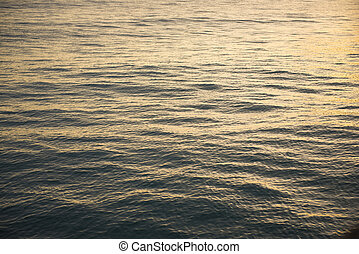 gold water surface at the sunset time