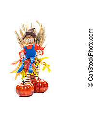 Scarecrow Sitting On Fall Leaves - Friendly scarecrow sits...