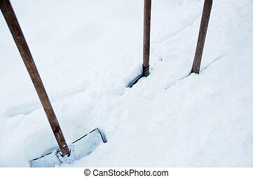 deep snow and spades - tree spades stuck into the deep snow