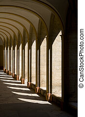 Convent - Sunlight through arches of medieval convent...