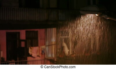 Rain in city at night - View part of port of Batumi from...