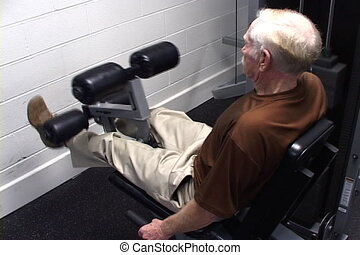 Senior Healthy Lifestyle - Elderly man works out on a leg...