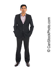 indian business man with coat standing