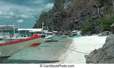 Traditional Philippines boats at tropical island - Beach at...