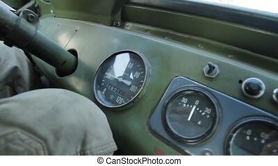 Tachometer in old car. Dashboard on a retro car. Military...