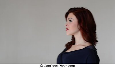 beautiful coquette young woman on gray background - Video...