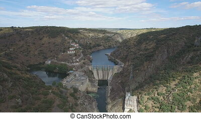Dam in arribes del Duero canyon - Aerial view, flying over...