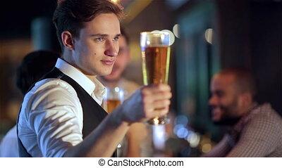 Best beer together - Four friends businessmen drink beer and...