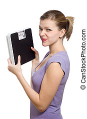 doubtful young woman holding a weight scale over white...