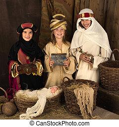 Smiling wisemen in christmas nativity scene - Three girls...