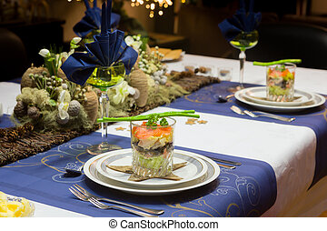 Christmas dinner table in blue - Decorated Christmas dinner...