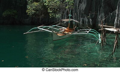 Traditional Philippines boat in lagoon view from boat -...
