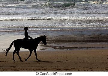 Cannon beach - Girl riding a horse at Cannon beach, Oregon...