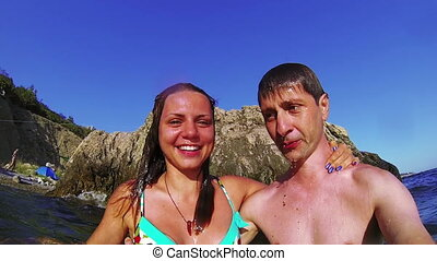 Kissing under sea water - Slow motion video of young couple...