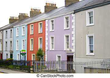 colorful houses with a to let sign