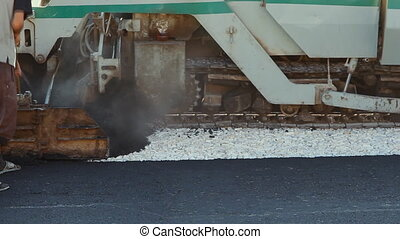 Laying asphalt pavement using special equipment. - Laying...