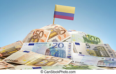 Flag of Colombia sticking in a pile of various european banknotes.(series)