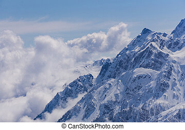 View on mountains and blue sky above clouds, Krasnaya...