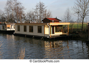 Houseboats on a river in the Netherlands