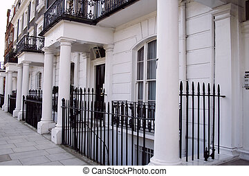 beautiful white terraced houses in London - a row of white...