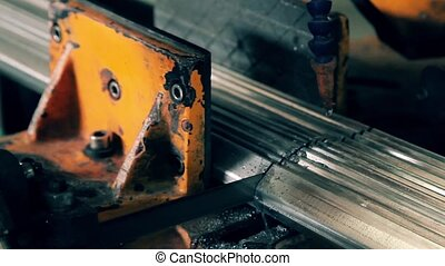 Industrial worker cutting metal - Industrial worker cutting...