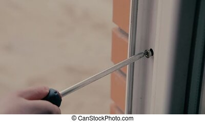 Girl assembling plastic window HD