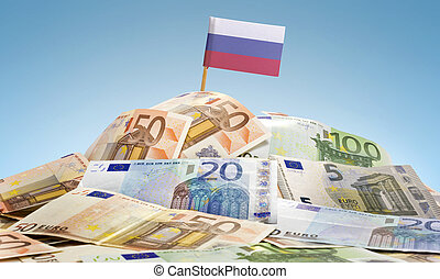 Flag of Russia sticking in a pile of various european banknotes.(series)