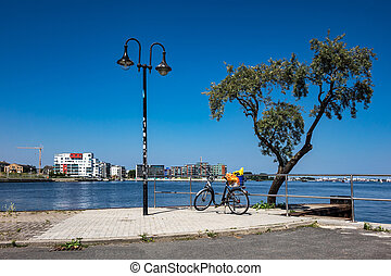 Promenade in the city port in Rostock Germany