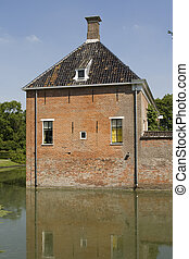 Beautiful ancient brick mansion with moat
