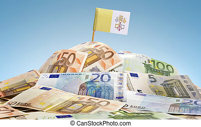Flag of Vatican City sticking in a pile of various european...