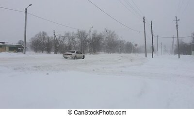 Cars driving on winter snowy road.