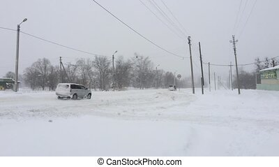 Cars driving on winter snowy road