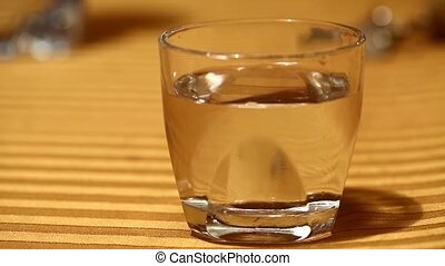Waves in a glass of water from sound blasts
