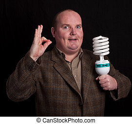 concept of male thinking and light bulb on black