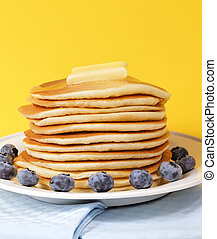 melted butter on pancake - Hot pancake staked with blueberry...