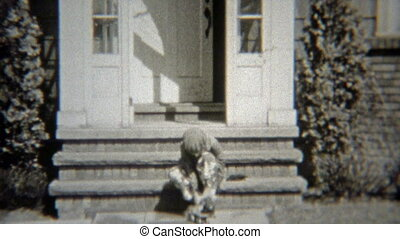 1938: Girl putting on rollerskates - Original vintage 8mm...