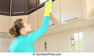 she cleans the kitchen - young girl cleans the kitchen