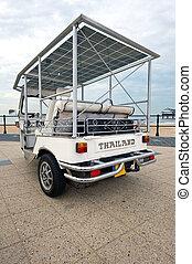 Solar powered cart  on a beach boulevard