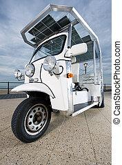 Solar powered cart  on the boulevard near the beach