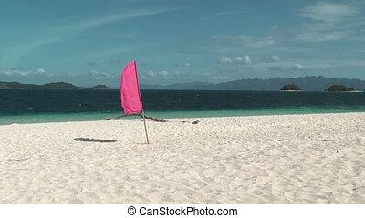 Flag on the tropical beach