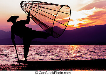 Silhouette of fisherman at sunset Inle Lake