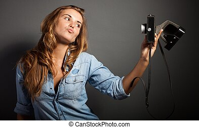 Attractive fit trendy modern hipster woman taking photos with