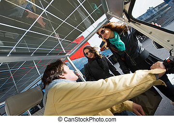 Solar powered tuc tuc fare - Two women discussing a fare in...